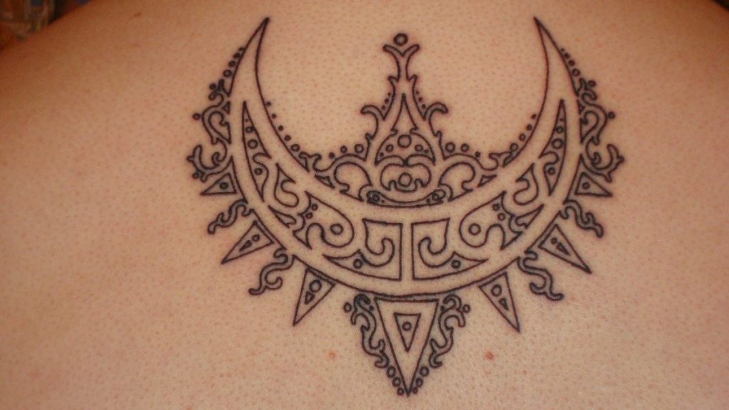 The Hidden Meanings Behind the Crescent Moon Tattoo