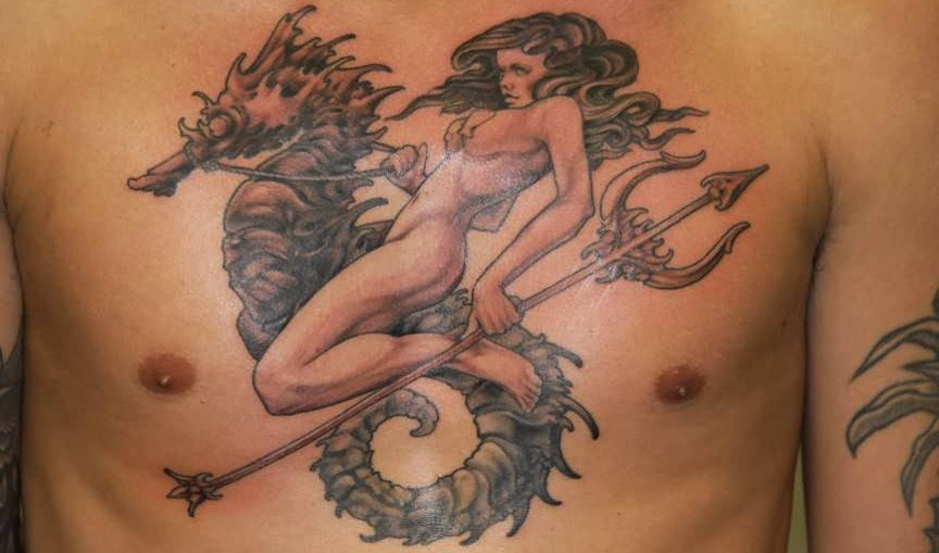 a-sea-goddes-rides-a-seahorse-and-carries-a-trident-in-this-large-tattoo-design