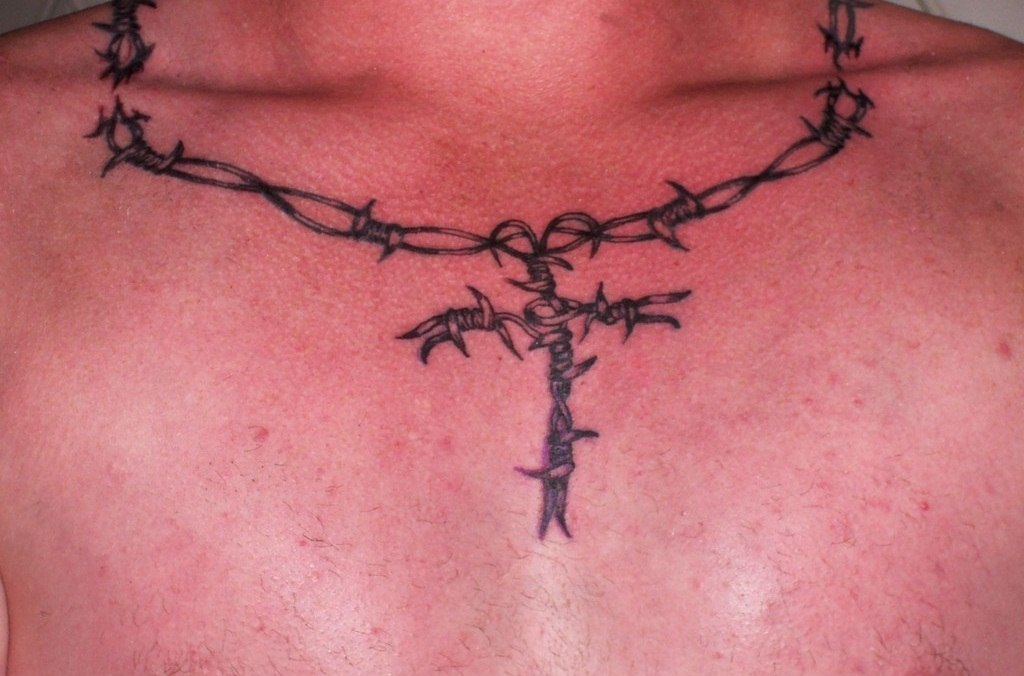 What is the meaning of barbed wire tattoos?
