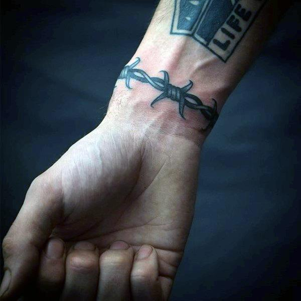 c6ffc65b60d 20 Barbed Wire Tattoos With Powerful and Creative Meanings - Tattoos Win
