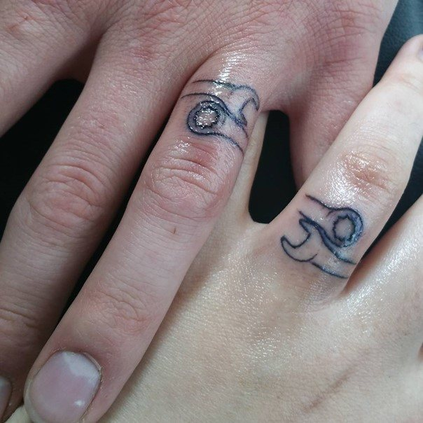 44 wedding ring tattoos with diversifying and creative meanings tattoos win - Wedding Rings Tattoos