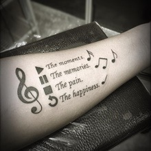 music tattoo on hand
