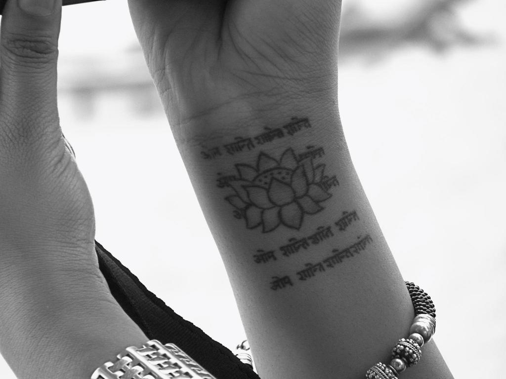 Lotus Tattoo With Shloka On Hand
