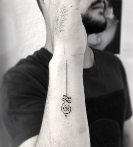 Unalome with Om tattoo on hand for man.