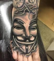 Anonymous Mask Tattoo On Leg