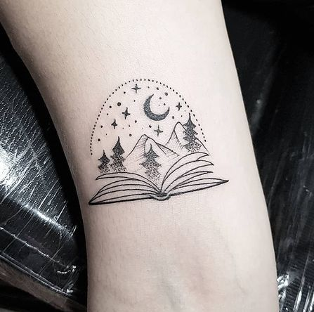 Open Book With Crescent Moon, Stars, Trees and Mountains Tattoo.
