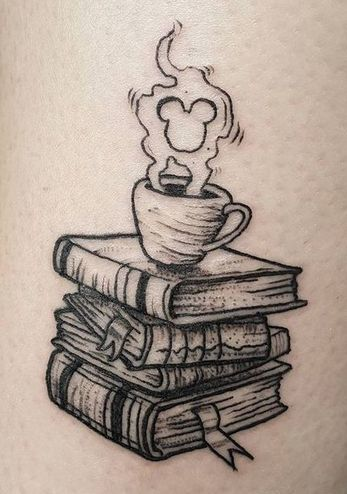 Stack Of Books having A Cup On It and Micky Mouse Smoke Tattoo.