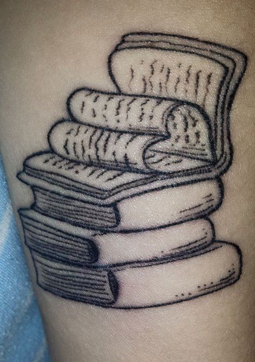 Stack Of Books WIth Pages Folded In Heart Shape Tattoo.