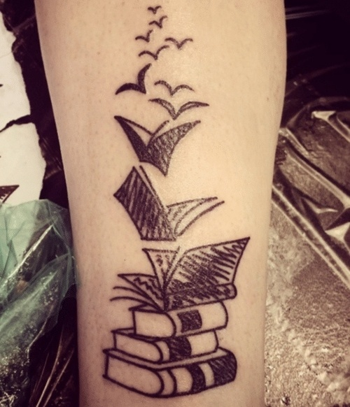 Stack Of Books With Birds Tattoo.