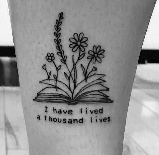 Open Book with Flowers Coming Out Of It Tattoo