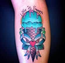 Ice Cream cone with ribbon tattoo with Life is Sweet written on it.