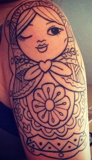 Russian Nesting Doll Tattoo With One Eye Closed Tattoo On Shoulder Woman