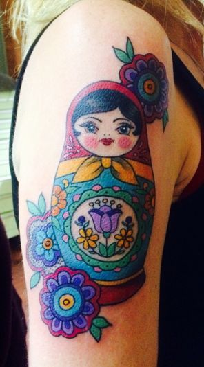 Russian Nesting Doll Tattoo On Shoulder Of A Girl