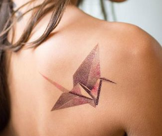 Origami Crane Tattoo On Back Of A Woman