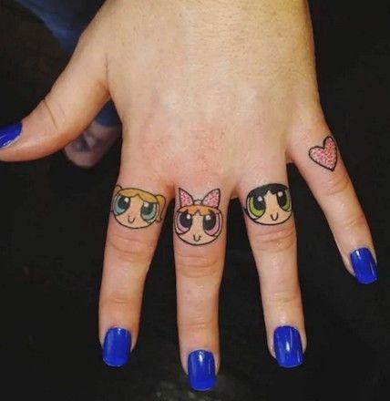 Powerpuff Girls Tattoo On Fingers Of A Woman