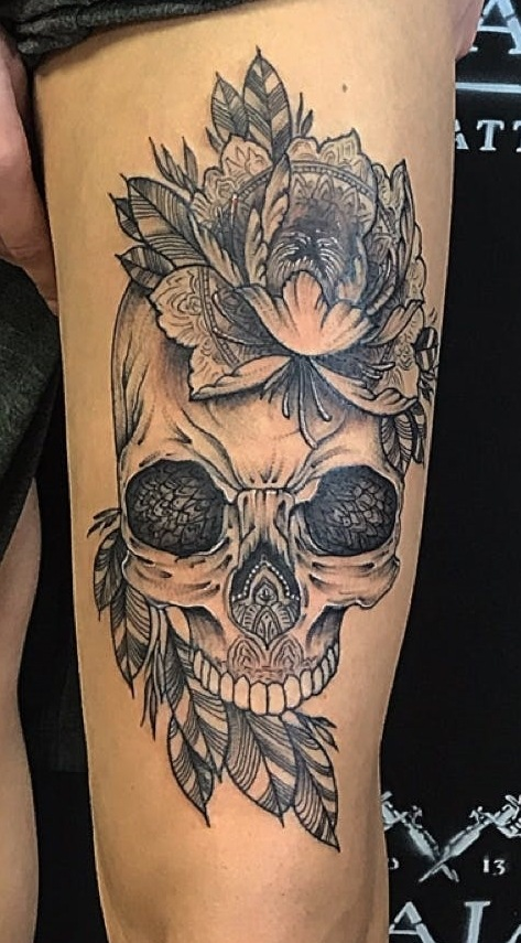 Rose And Skull Tattoo On Thigh Of A Girl