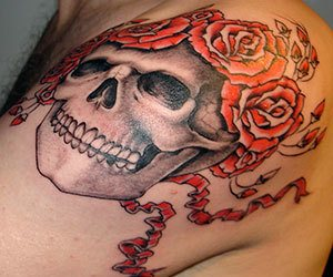 Rose And Skull Tattoo On Soulder On A Man
