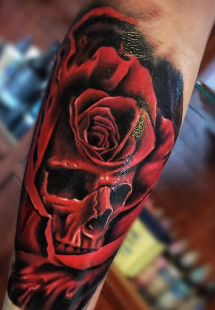 Red Rose And Skull Tattoo On Hand