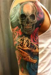 Rose And Skull Tattoo On Shoulder And Bicep Of A Man