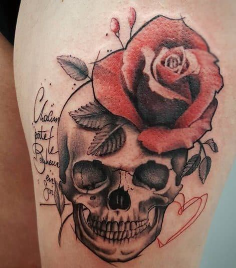 Rose And Skull Tattoo With Quote on Thigh Of A Girl
