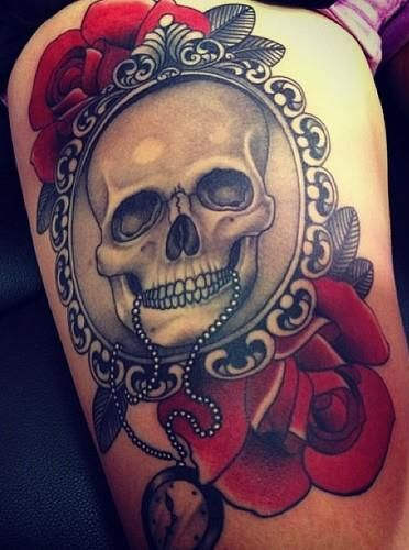 Rose And Skull In Mirror Tattoo On Thigh Of A Woman