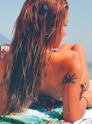 Palm Tree Tattoo On Hand Of A Girl
