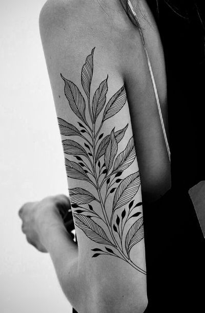 Plant Tattoo On Hand Of A Woman