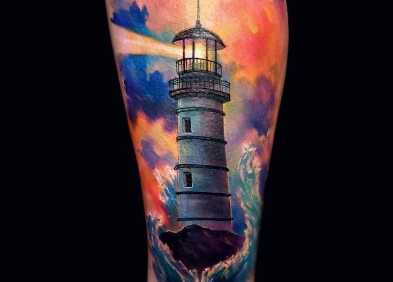 Lighthouse tattoo for man.