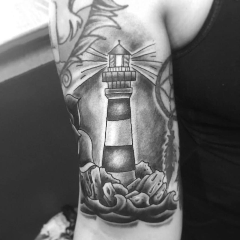 Lighthouse Tattoo in black colour  symbolism