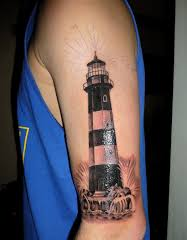 Lighthouse tattoo on hand.