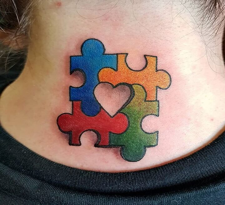Puzzle Piece Tattoo on Neck of a woman.