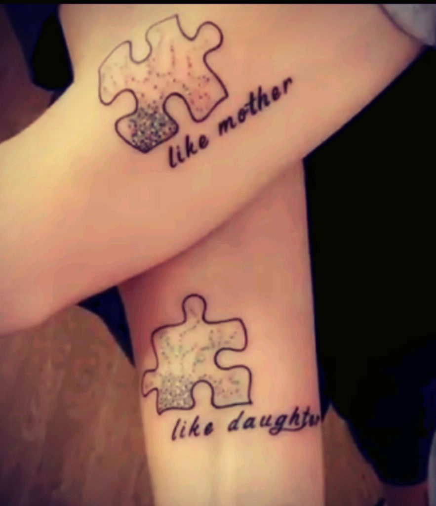 Like Mother Like Daughter Puzzle Piece Tattoo On Hand.