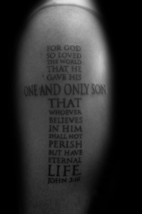 John 3:16 Verse Written in shape on cross tattoo on shoulder.