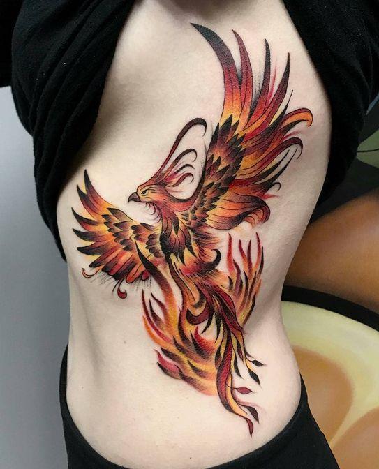 Hot Phoenix Tattoo on side of a woman.