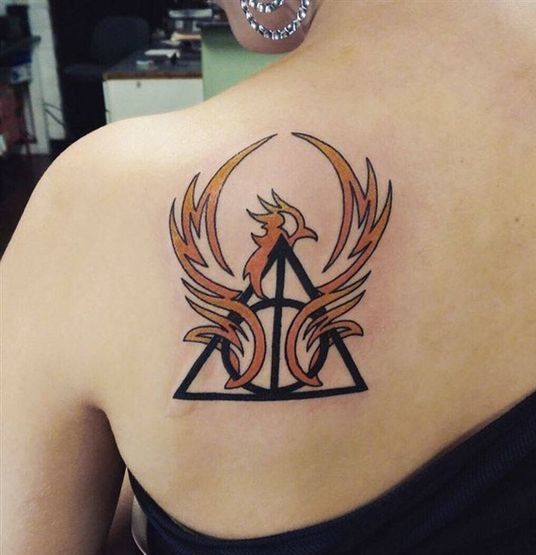 Phoenix Tattoo with triangle and circle on back of a girl.