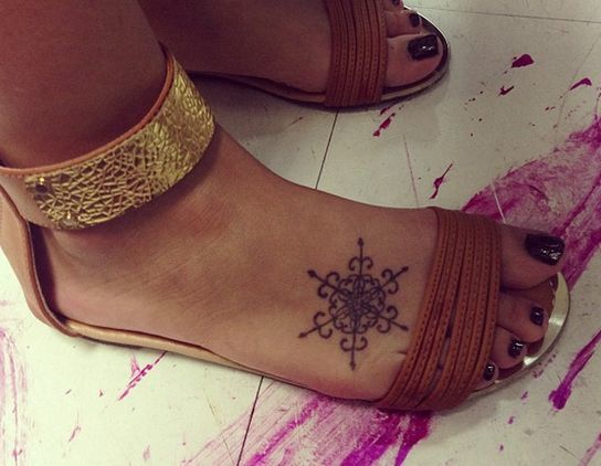 Snowflake Tattoo on leg of a girl.