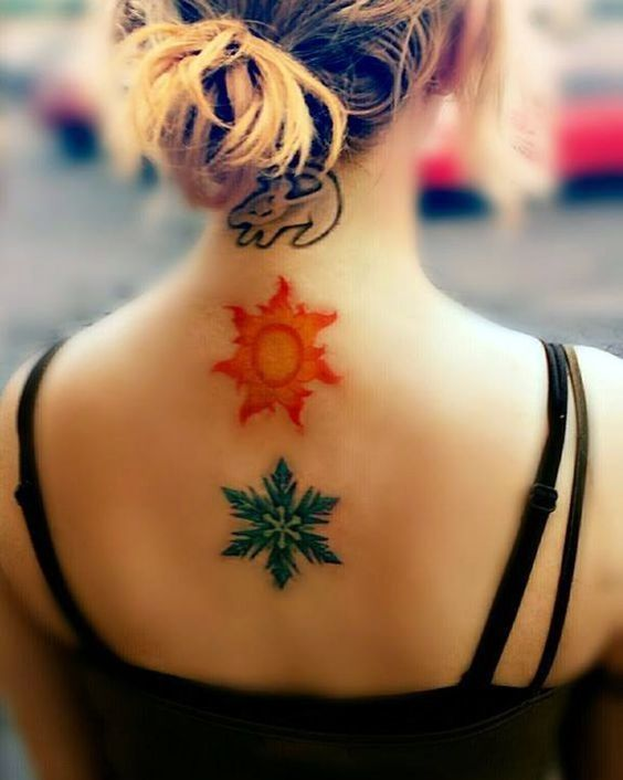 Snowflake Tattoo on back of a woman.