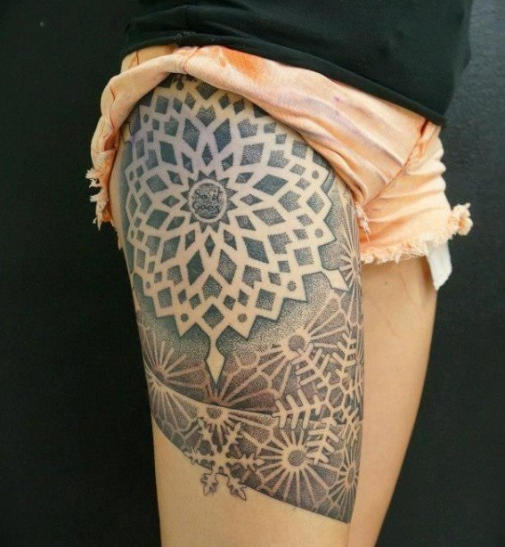 Snowflake Tattoo On Thigh Of A Girl.