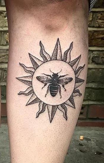 Sun And Bee Tattoo On Leg