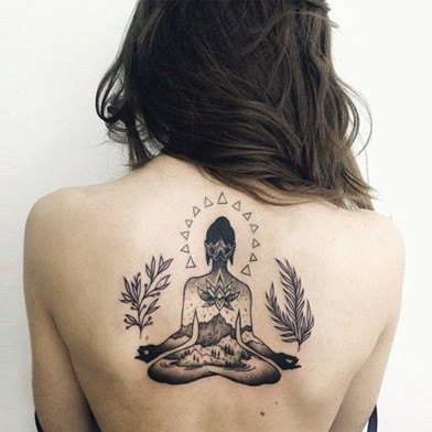 Meditation Symbol Tattoo On Back Representing Power.