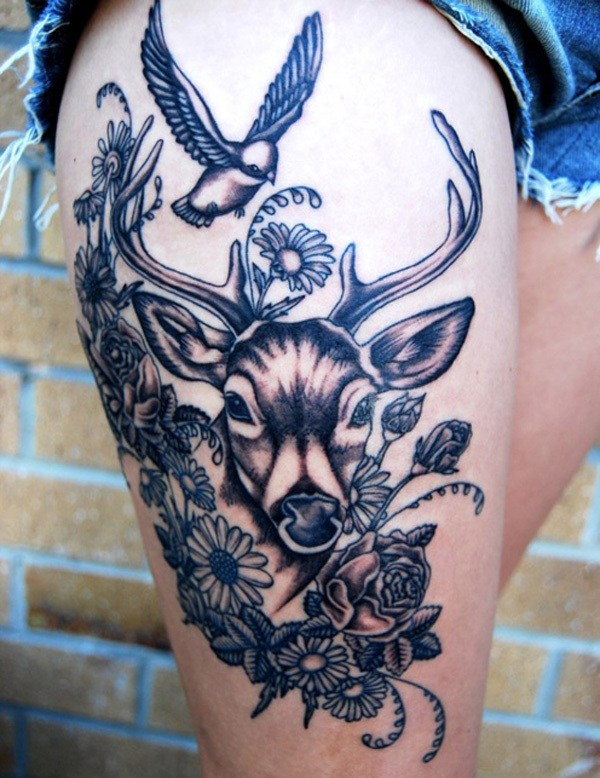 Deer With Flower Tattoo On Thigh Representing Power.