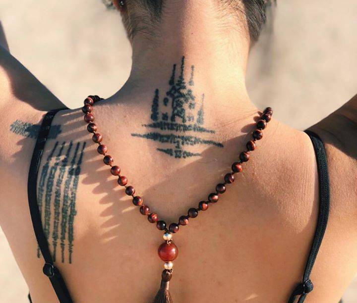 Na Maha Samred Tattoo On Neck Representing Power.
