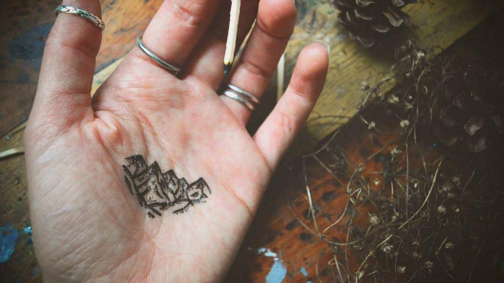 Mountain Tattoo on palm for men and women