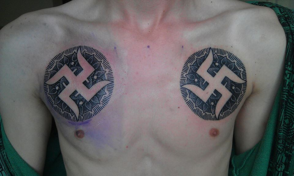 Swastik Tattoo on chest for men
