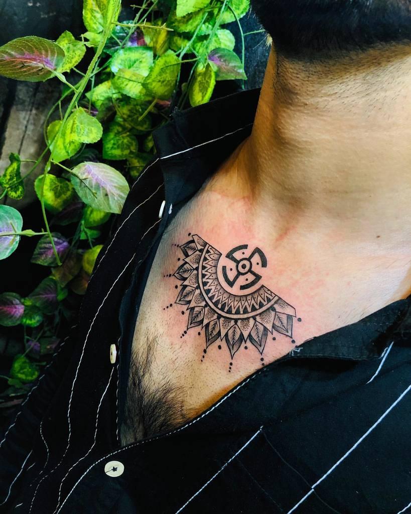 beautiful Swastik Tattoo on neck