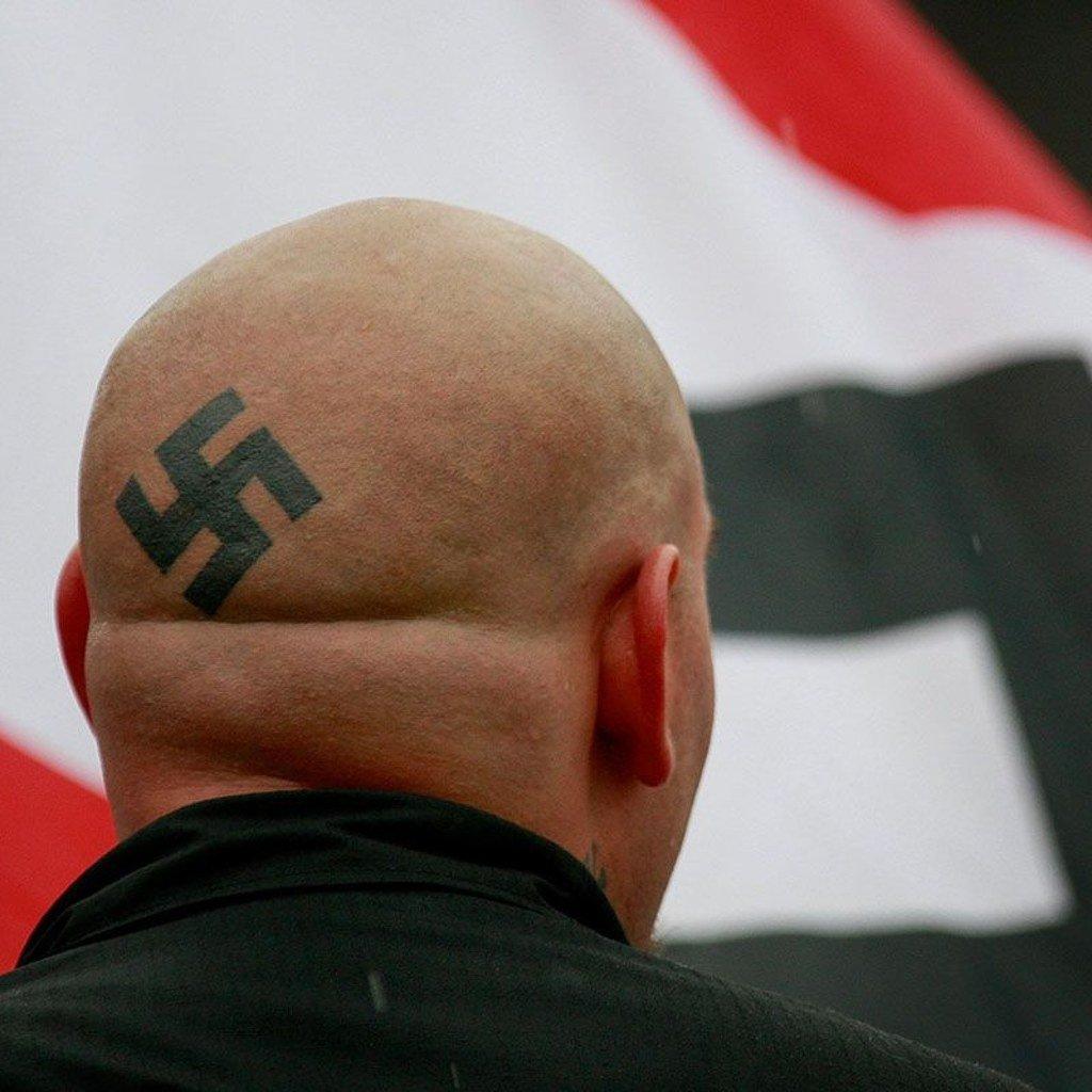 Swastik Tattoo on head