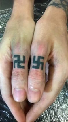Swastik Tattoo on finger