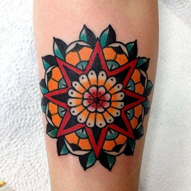 Colorful star tattoo on leg