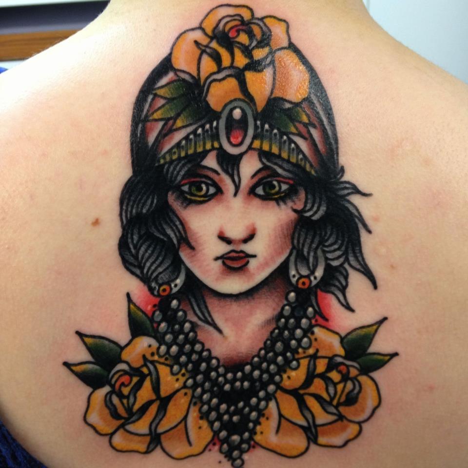 Cute Gypsy Tattoo on neck for women