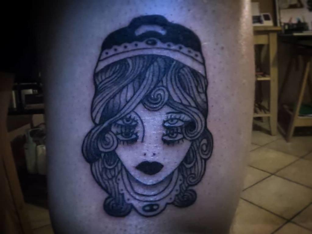 Ghost Gypsy Tattoo on thigh.